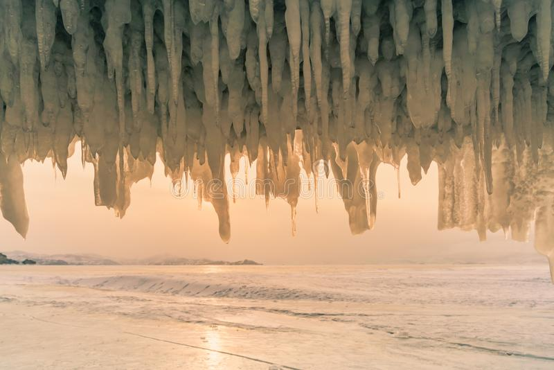 Freezing waterfall in ice cave in Baikal water lake Russia winter season royalty free stock photos