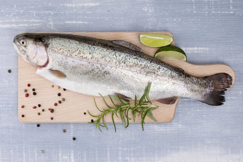 Freh trout on kitchen board. stock photos