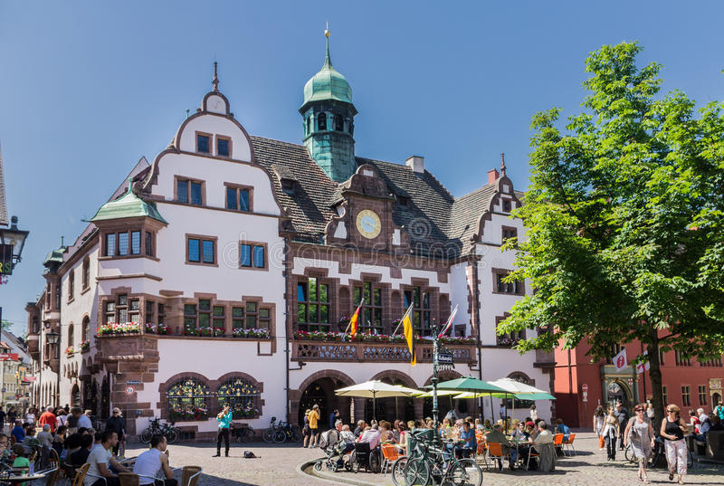 Freiburg Germany. A plaza and a typical historical house with a bronze tower. Freiburg Germany stock images