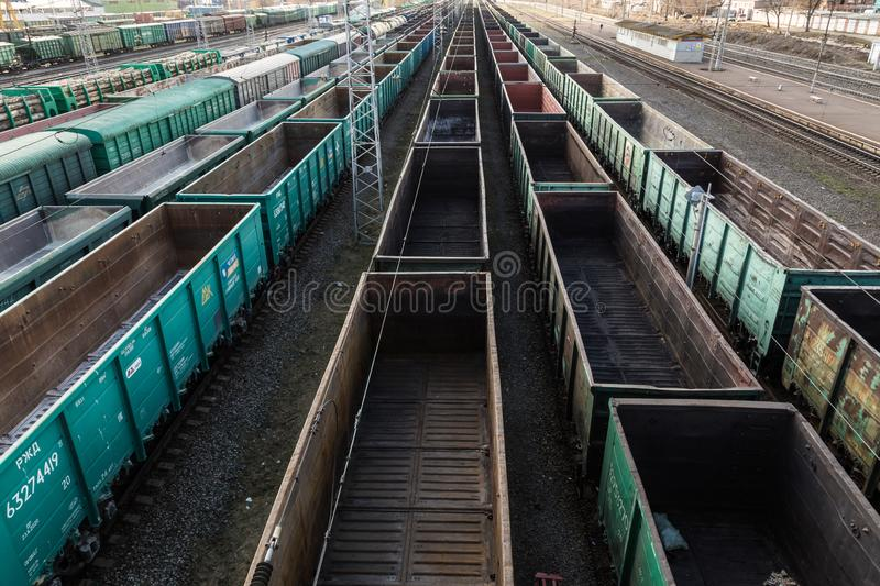 Freight cars at a large railway station. Cargo transportation and railway trains.  stock photos