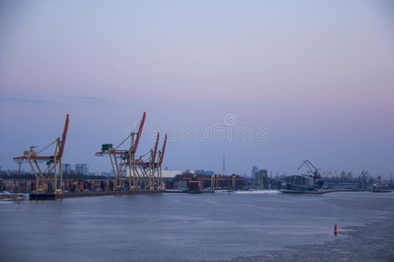 Freight shipping containers and gas tanks at the docks. in import export and business logistic. Trade Port, Ship cargo to harbor. Freight shipping containers stock photo