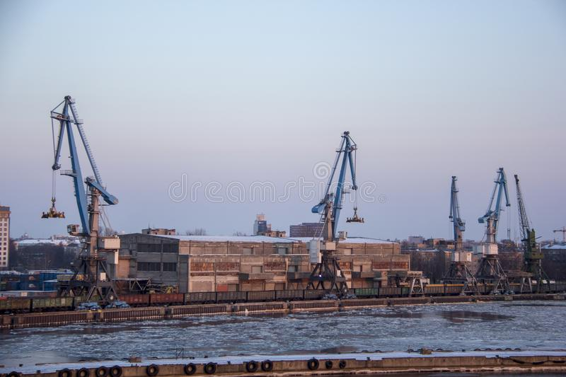 Freight shipping containers and gas tanks at the docks. in import export and business logistic. Trade Port, Ship cargo to harbor. Freight shipping containers royalty free stock images
