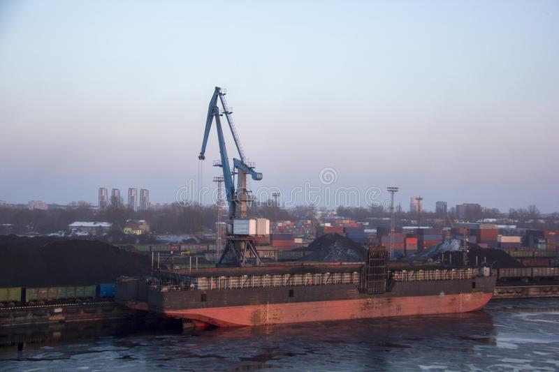 Freight shipping containers and gas tanks at the docks. in import export and business logistic. Trade Port, Ship cargo to harbor. Freight shipping containers royalty free stock image