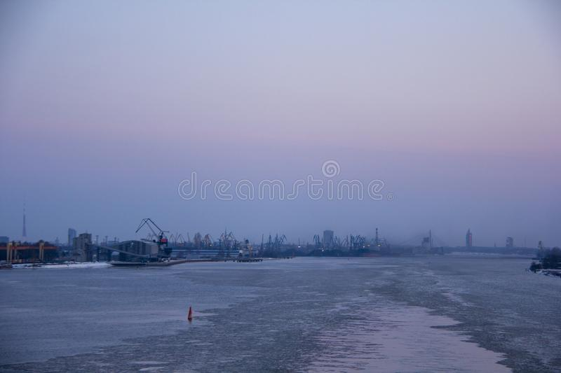 Freight shipping containers and gas tanks at the docks. in import export and business logistic. Trade Port, Ship cargo to harbor. Freight shipping containers royalty free stock photo