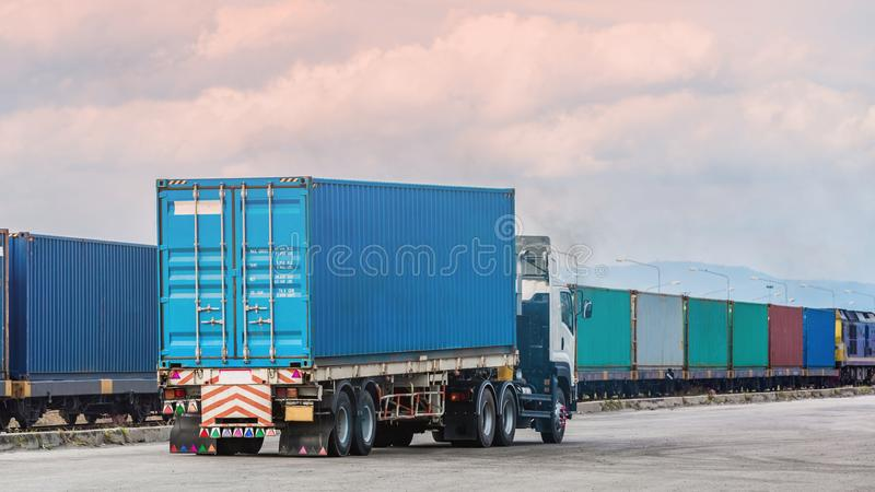 Freight trailer with cargo container and freight train with cargo containers background, import export business logistic. royalty free stock image