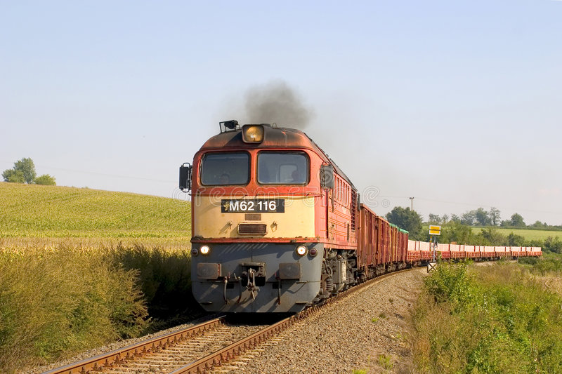 Freight train. Near Bonyhád, Hungary. It is hauled by a type M62 locomotive (Sergei royalty free stock photo