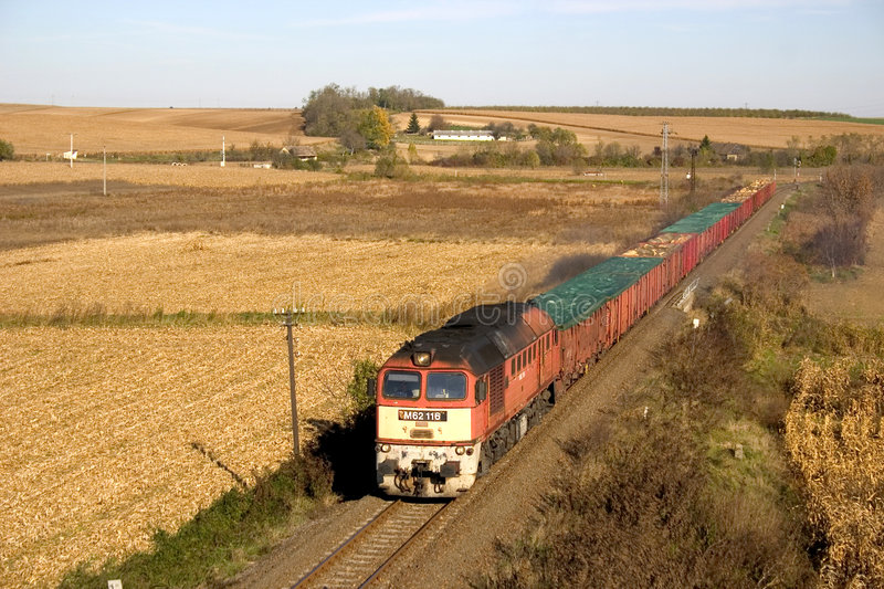 Freight train. Hungarian freight train hauled by a type M62 (Sergei), transporting wood and scrap-iron royalty free stock photo