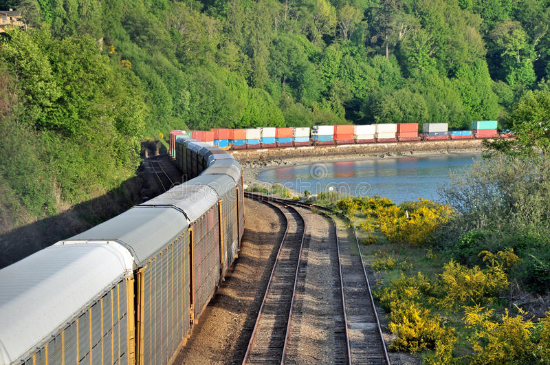 Freight train. The freight train moving along the coastline royalty free stock images