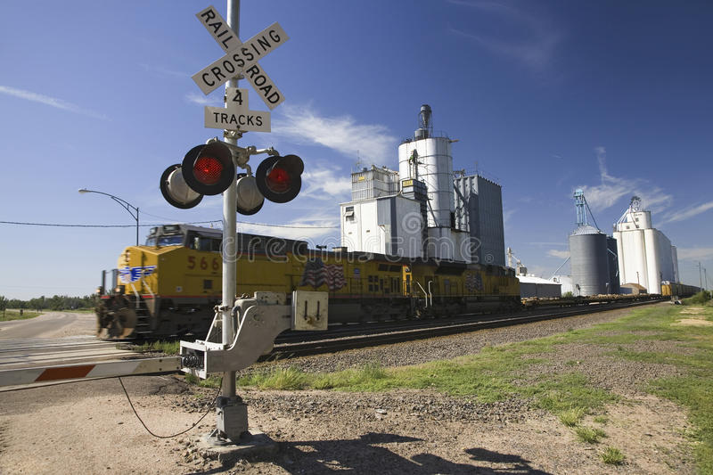 Freight train. And blinking crossing light in Big Springs, Nebraska stock photos