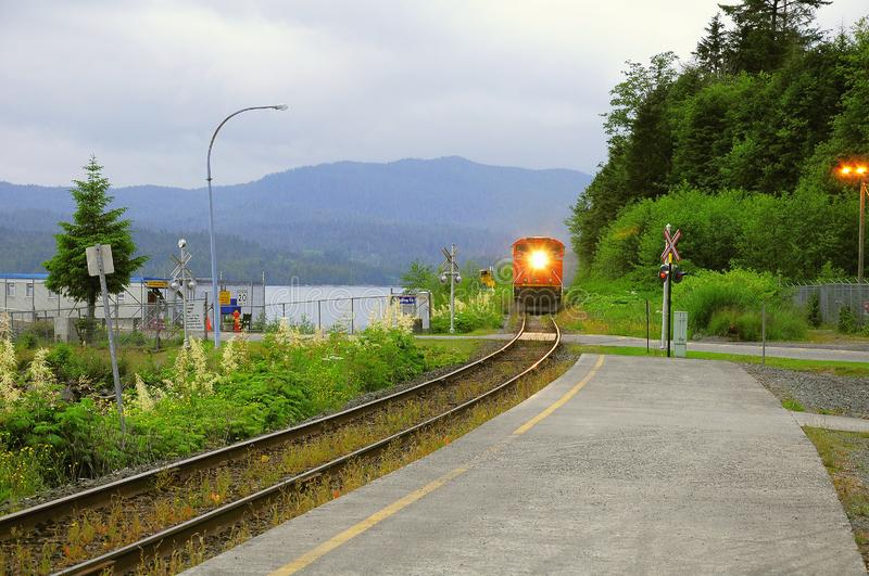 Freight train approaches to the station. Prince Rupert. Canada stock images