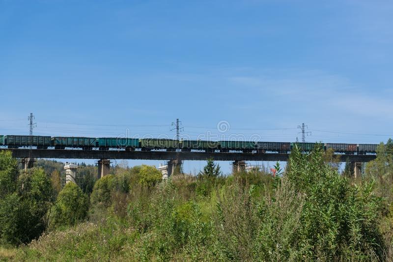 Freight train on bridge stock photography