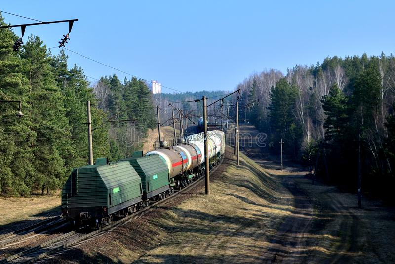 Freight train with cargo wagons. Logistics of rail freight stock photography