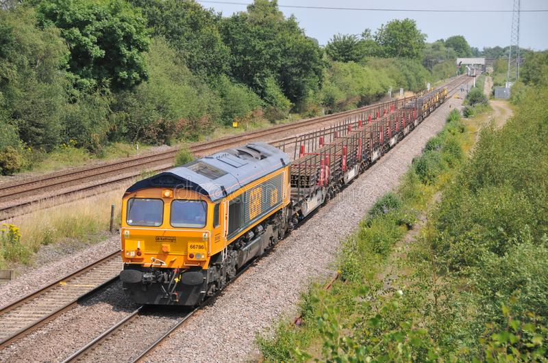Freight train with continuous welded rail CWR royalty free stock image