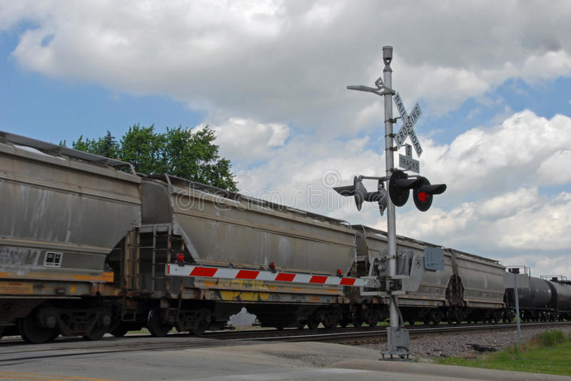 Freight train at crossing gate royalty free stock image