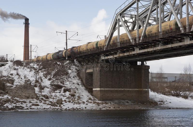 Freight train crossing the river Sukhona in Sokol, Vologda region of Russia royalty free stock images
