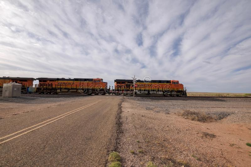 Train Crossing a Road in New Mexico royalty free stock photo