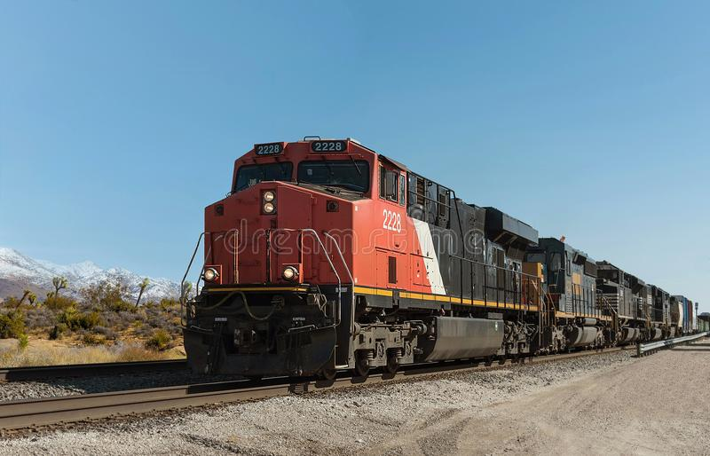 Freight Train in Desert Landscape stock photos