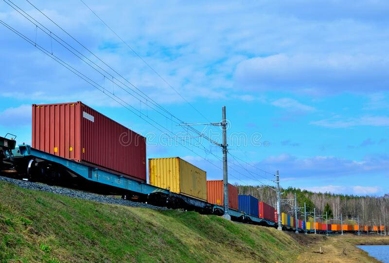 Freight train, transportation of railway cars by cargo containers shipping. Railway logistics concept.  royalty free stock image