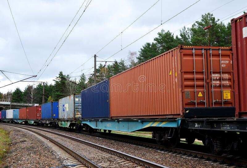 Freight train, transportation of railway cars by cargo containers shipping. Railway logistics. Concept royalty free stock images