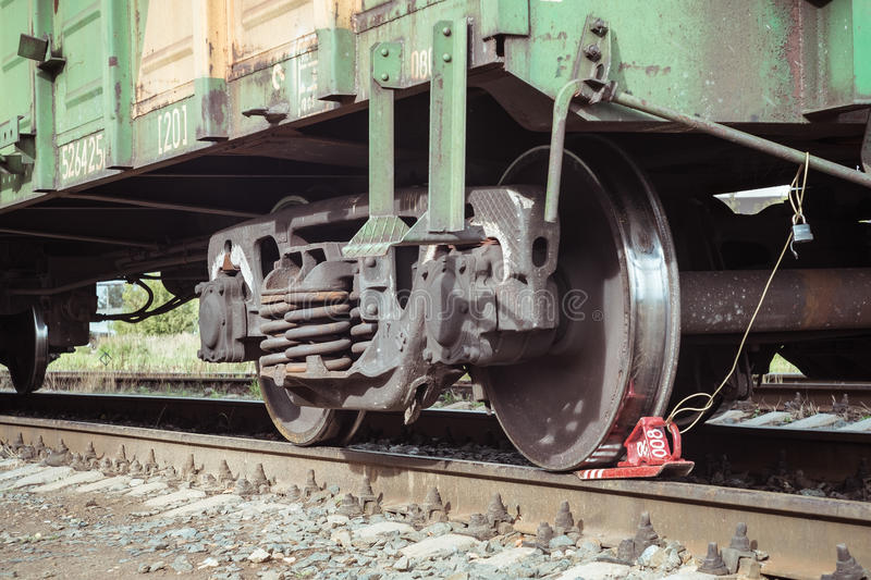 Freight train with a wheel chock at the platform stock image