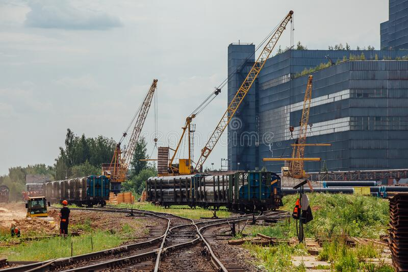 Freight trains with cargo on railroad junction.  royalty free stock images