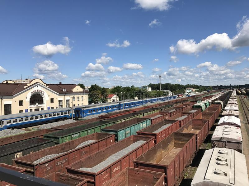 Freight trains at the railway station. Open freight wagons with cargo royalty free stock photos