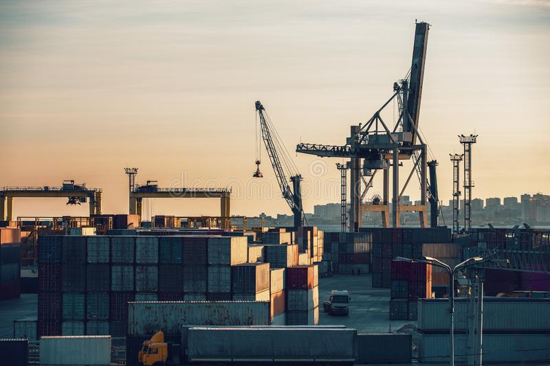 Freight transportation sea port, cargo containers with cranes, industrial business water shipping and logistic terminal. Toned stock images