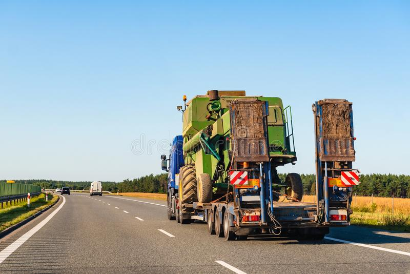 Freight truck on a highway. In a rural landscape royalty free stock image