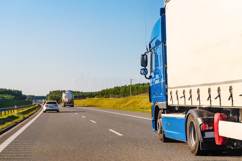 Freight truck on a highway. In a rural landscape stock images