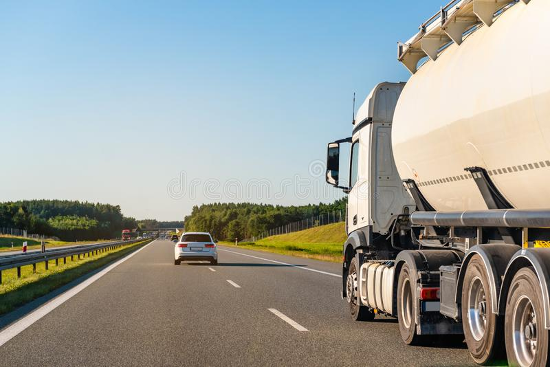 Freight truck on a highway. In a rural landscape royalty free stock photography