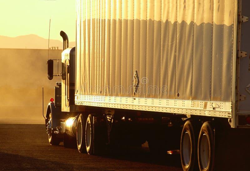 Freight truck on I-40 Arizona. During sunset royalty free stock photography