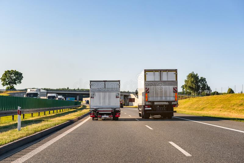 Freight trucks on a highway. Concept of safe driving royalty free stock photography