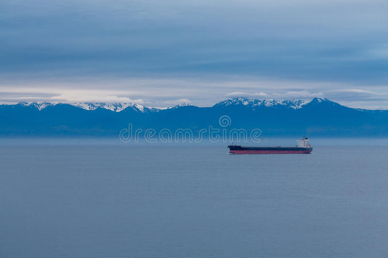 Freighter on Blue royalty free stock photo