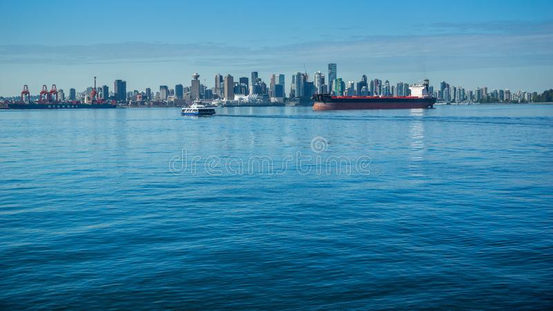 Freighter in front of the Vancouver Skyline royalty free stock images