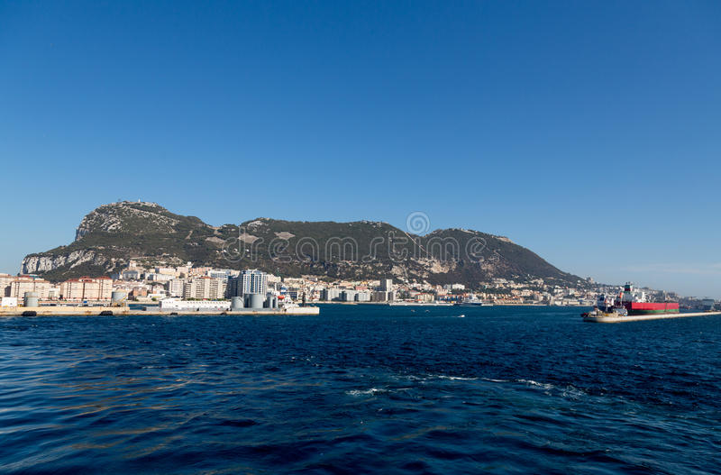 Freighter Steaming Past Gibraltar stock image