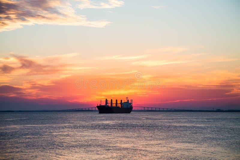 Freighter on Sunset Horizon stock photos