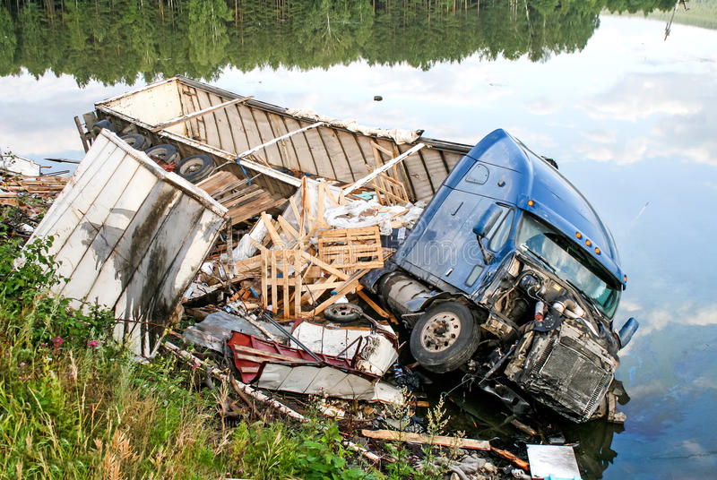 Freightliner Century Class. CHELYABINSK REGION, RUSSIA - AUGUST 14, 2009: Semi-trailer truck Freightliner Century Class crashed in the lake from the interurban royalty free stock image