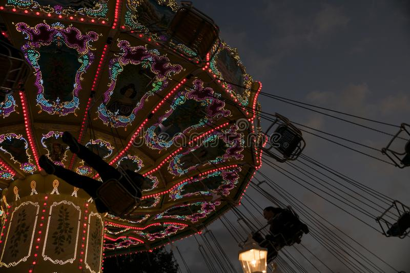 Freimarkt, Bremen,Germany, April 14th, 2017: Fast ride on an illuminated chairoplane with high flying chairs stock image