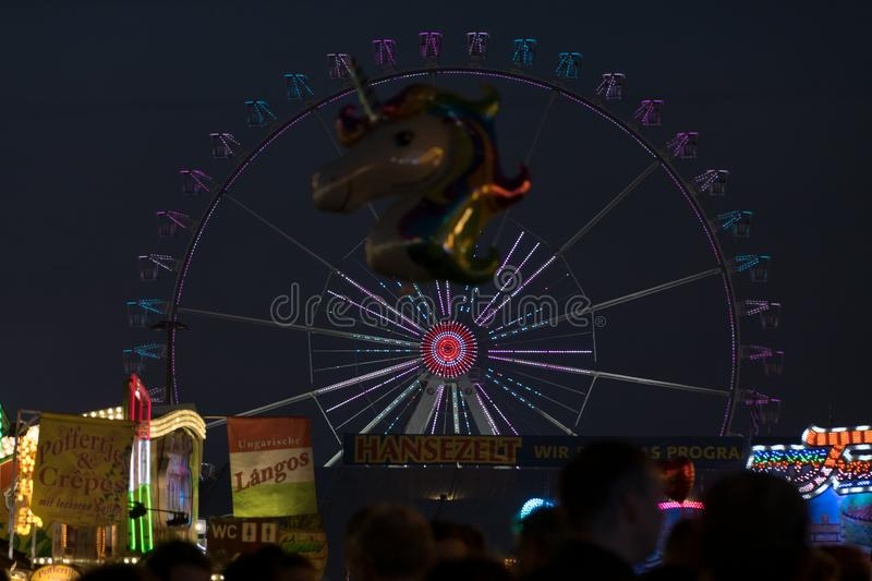 Freimarkt, Bremen, Germany, April 14th, 2017: Illumiated large ferris wheel and fun fair scenery stock image