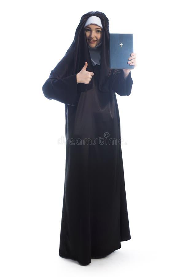 A freira anuncia a Bíblia imagens de stock