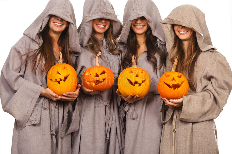 Freiras com abóboras de Halloween fotografia de stock