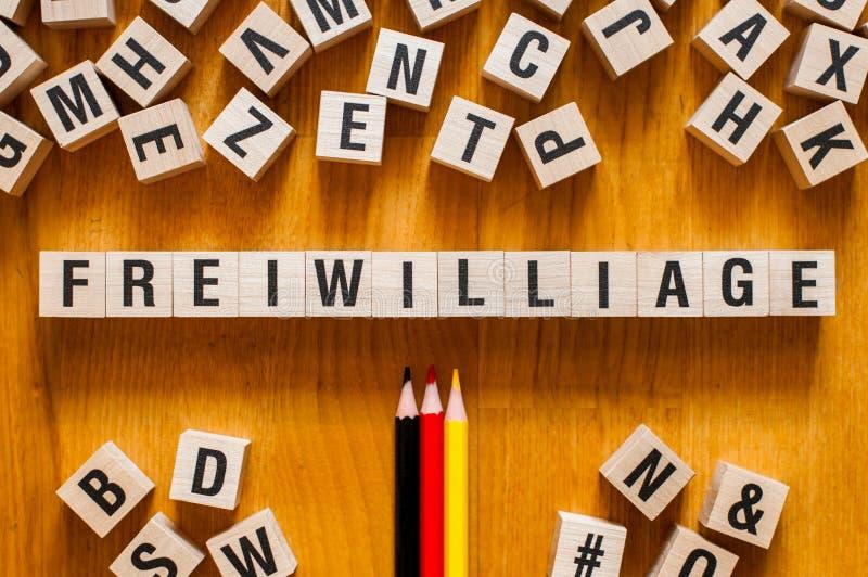 Freiwilliage - ordvolontär på tyskt språk, ordbegrepp royaltyfri foto