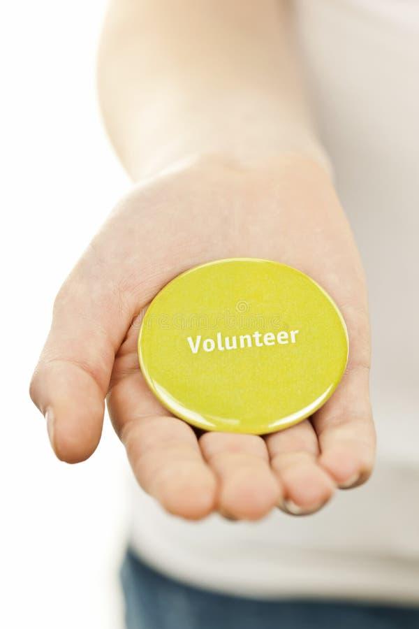 Freiwilliger Knopf an Hand lizenzfreies stockfoto