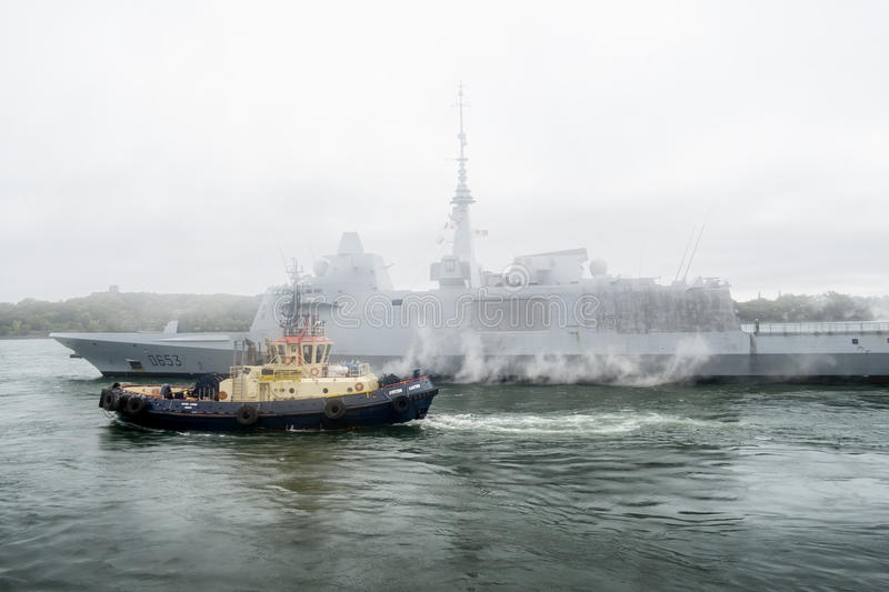 FREMM Languedoc & Svitzer Cartier tugboat. The FREMM multi-mission frigate Languedoc carried out a four-day port visit in Montréal from September 24th to 28th stock photos