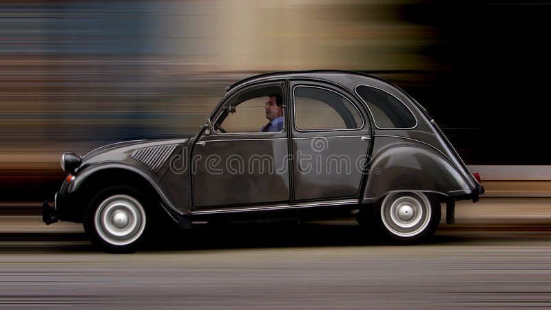 French 2CV car. A side view from a vintage brown french 2CV car speeding royalty free stock images