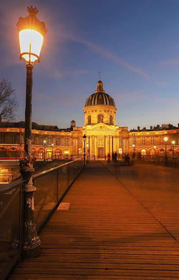 The French Academy at night , Paris, France. The French Academy is pre-eminent French council for matters pertaining to the French language.It was established royalty free stock image