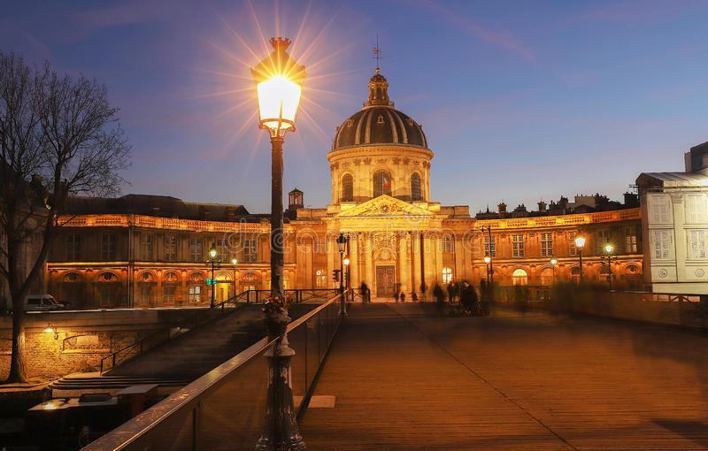 The French Academy at night , Paris, France. The French Academy is pre-eminent French council for matters pertaining to the French language.It was established royalty free stock images
