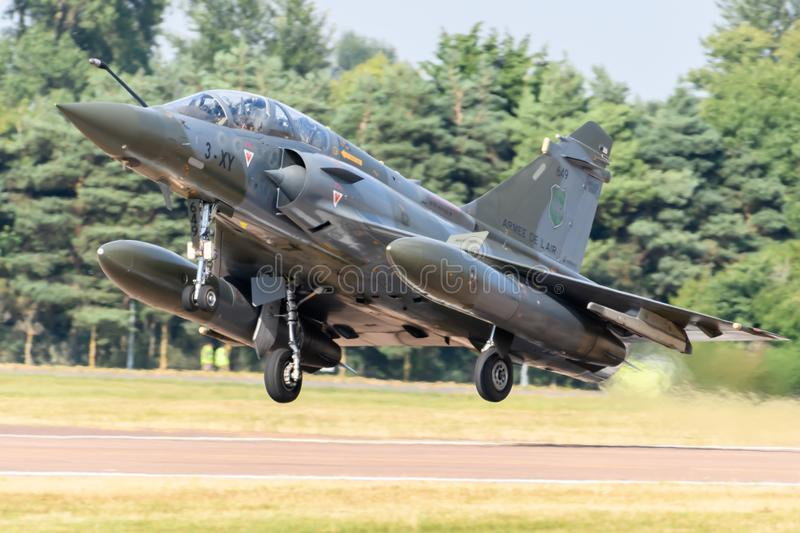 French Air Force Dassault Mirage 2000 aircraft. Performing at the Royal International Air Tattoo in July 2018 royalty free stock image