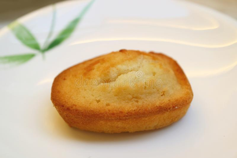 French Almond Petit-Four Cake Called Financier Served on White Plate stock images
