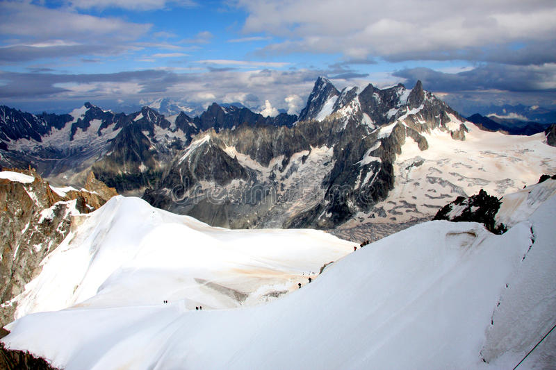 French Alps. The Alps are one of the great mountain range systems of Europe stretching approximately 1, 200 kilometres (750 mi) across eight Alpine countries stock images